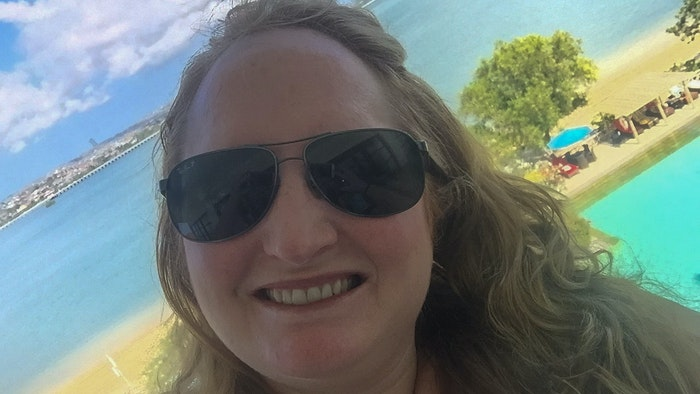 Melissa taking selfie on the beach during a self-care holiday.