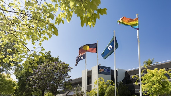 Flags flying high outside Shepparton campus.
